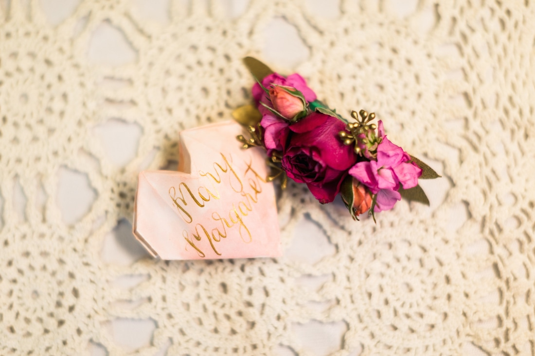 Galentine's Day Party Inspiration: Place setting details - Origami watercolor name hearts with floral hair clips